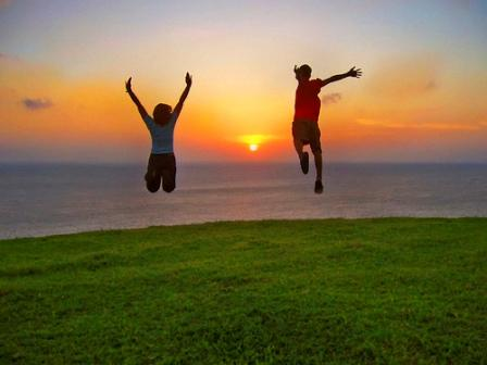 Two people leaping in joy